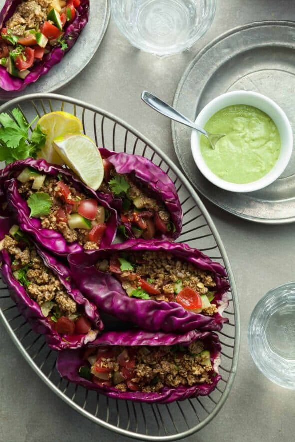 Raw Vegan Tacos with Spicy Zucchini Salsa and Creamy Cilantro Sauce in Serving Basket