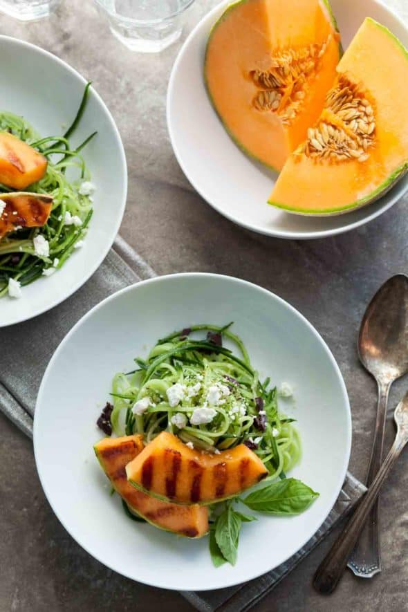 Grilled Melon Salad with Cucumber Noodles in Bowls on Table