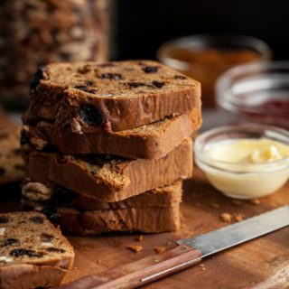 This gluten-free, paleo fruit and nut loaf is packed with chewy bits of dried fruit like dates, raisins and cherries along with nuggets of pecans and hazelnuts, in a batter lightly scented of vanilla with just a pinch of cinnamon. It's a snacking loaf, the kind you serve for breakfast, brunch, or an afternoon nibble, warm or toasted with plenty of butter alongside.
