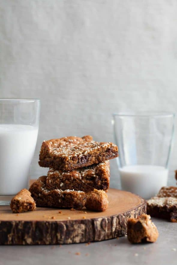 Tahini Blondies Stacked Near Glass of Milk