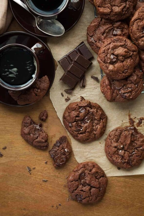Paleo Double Chocolate Cookies on Parchment with Coffee Cups