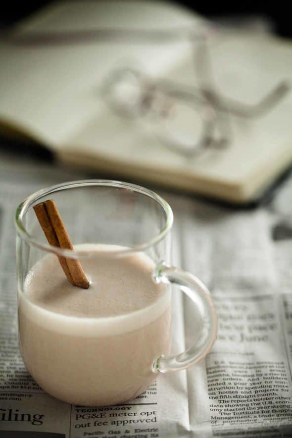 Warm Spiced Cashew Coconut Milk in Glass Mug on Newspaper