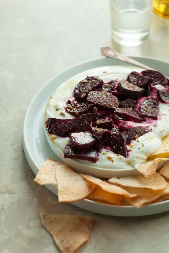 Honey roasted beets are served on a bed of whipped goat cheese yogurt dip and sprinkled with dukkah.