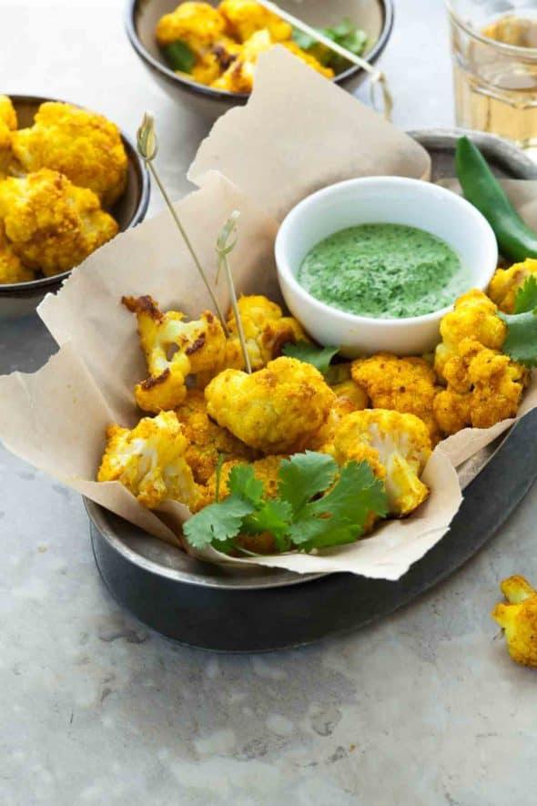 Turmeric Roasted Cauliflower Poppers with Cilantro Chutney Dip