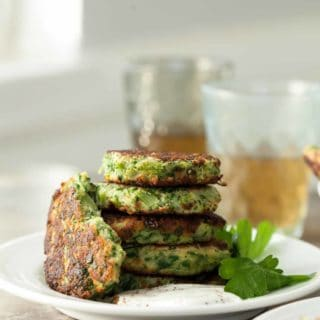 Broccoli Goat Cheese Fritters with Sumac Yogurt - Stuffed with broccoli, goat cheese and herbs, these fritters are golden brown on the outside and soft and tender on the inside.