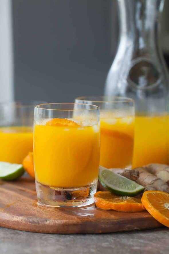 Tangerine Turmeric Tonic - Start your day off right with a glass of spicy, sweet tangerine turmeric tonic.
