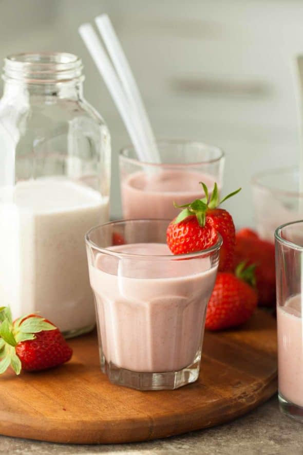 Strawberry Cashew Milk in Glass with Strawberry on Rim