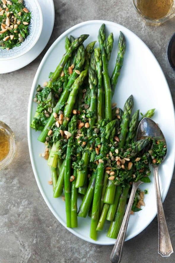 Asparagus with Caper Pine Nut Gremolata (Paleo, Vegan) - Asparagus spears get all dressed up with a lively caper and herb dressing.