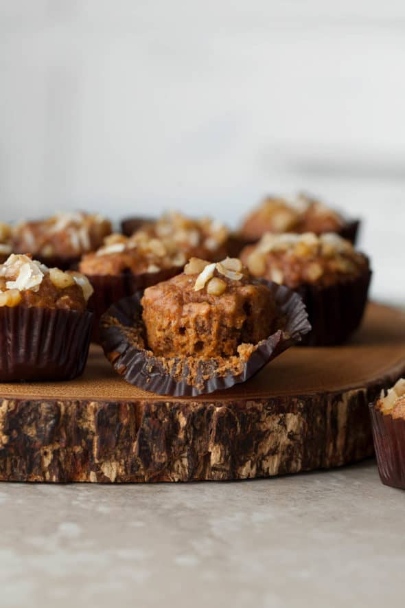 Mini Applesauce Carrot Cake Muffins (Gluten-Free, Paleo) - Loaded with applesauce and carrots these soft and tender carrot cake muffins are the perfect on-the-go breakfast or snack.