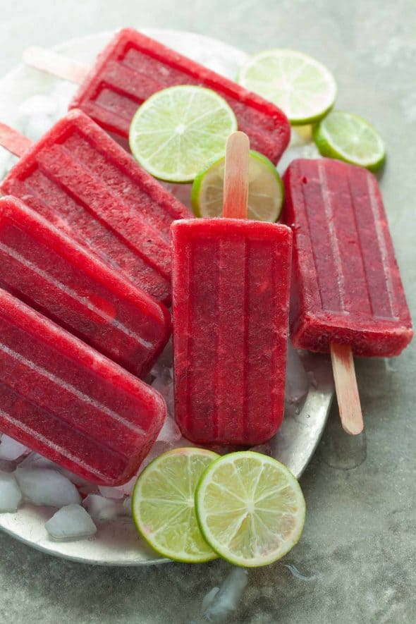 Probiotic Cherry Lime Popsicles over Ice on Plate