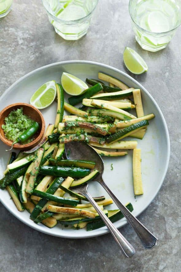 Sauteed Chili Lime Zucchini on Platter with Lime Wedges