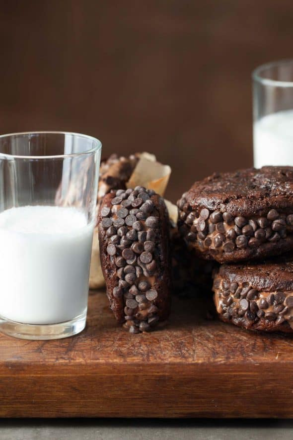Double Chocolate Ice Cream Sandwiches Next to a Glass of Milk