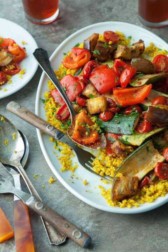 Roasted Ratatouille with Cauliflower Couscous (Paleo, Vegan) - An easy oven-roasted and harissa spiced ratatouille served with cauliflower couscous.