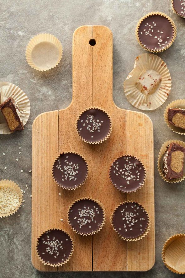 Dark Chocolate Tahini Cups on Wood Board