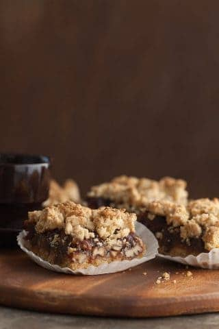 Pecan Date Bars Recipe (Paleo,Vegan) - Sweet date caramel and roasted pecans are sandwiched between layers of crisp and crumbly dough in these paleo and vegan date squares.