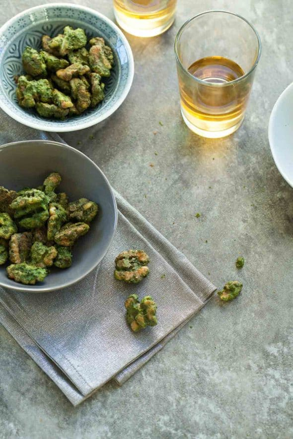 Pesto roasted walnuts make the perfect snack or appetizer anytime of year.