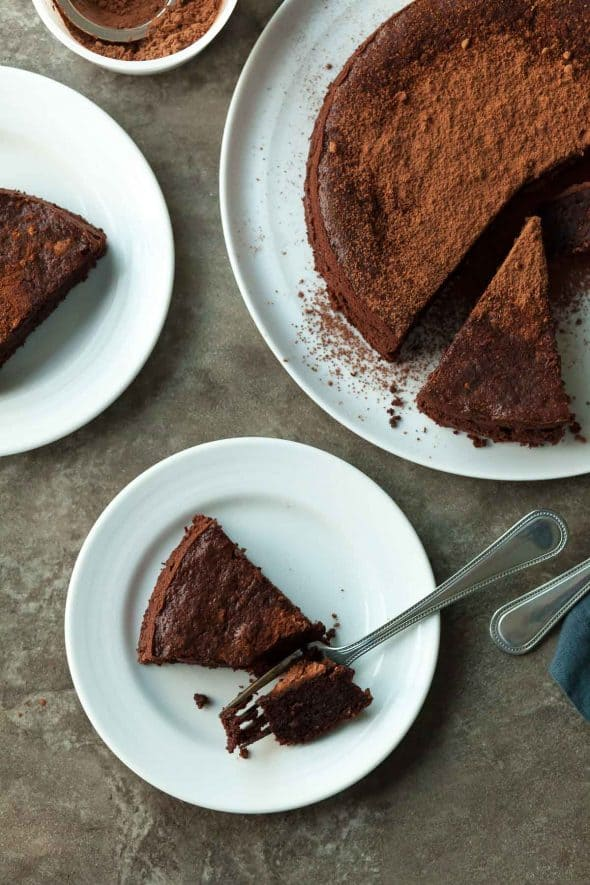 Flourless Chocolate Walnut Torte on Plates with Forks