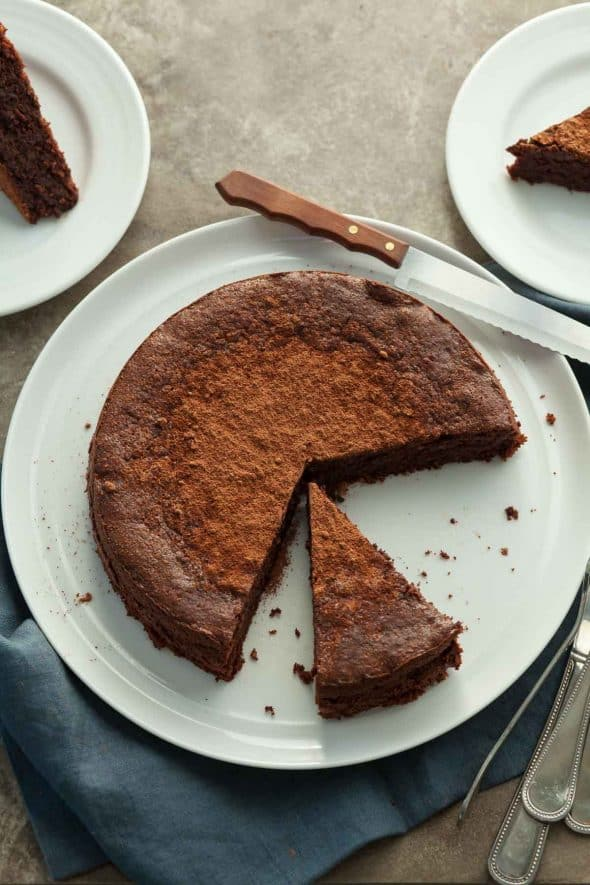 Flourless Chocolate Walnut Torte on Plate with Knife
