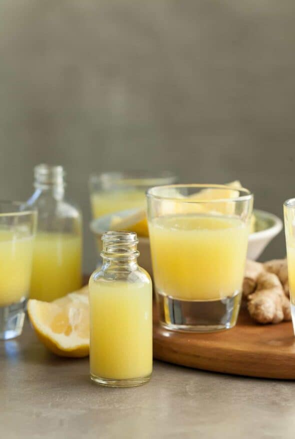 Pineapple Ginger Wellness Shots in Shot Glasses and Bottles