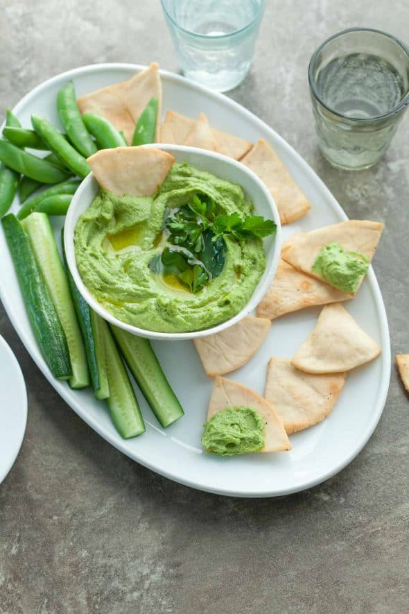 Spicy Green Almond Hummus in Bowl with Chips and Crudites.