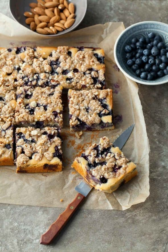 Blueberry Almond Streusel Coffee Cake on Parchment with Knife