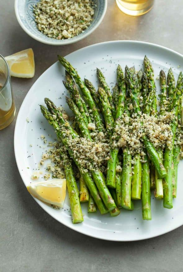Grilled Lemon Poppy Seed Asparagus on Plate with Lemon Wedge