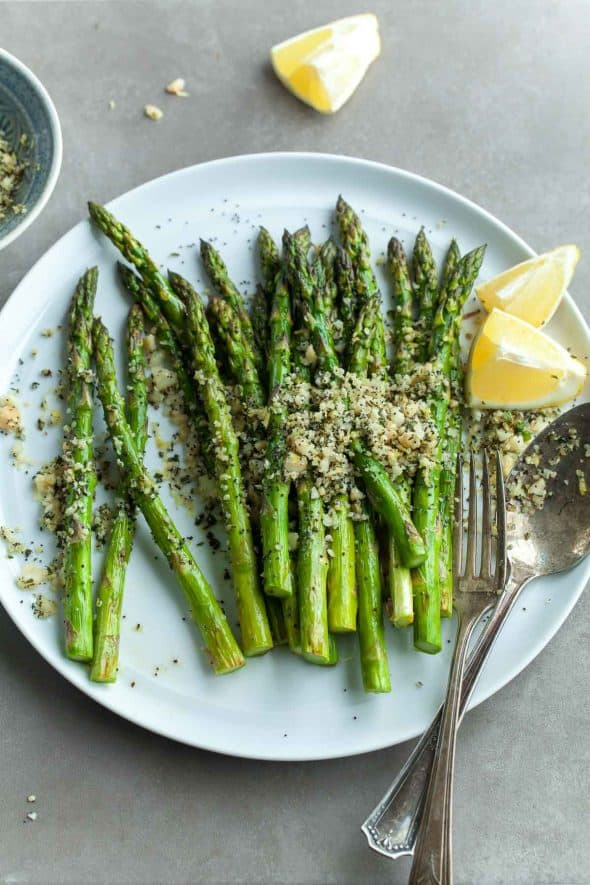 Grilled Lemon Poppy Seed Asparagus on Plate with Macadamia Nut Topping