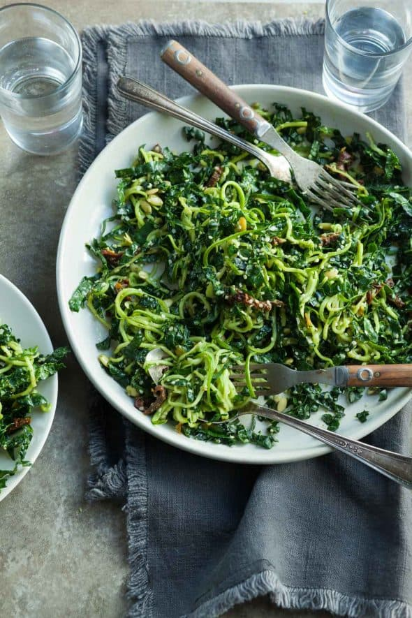Zucchini Noodle, Kale and Sun-dried Tomato Salad with Forks on Plate
