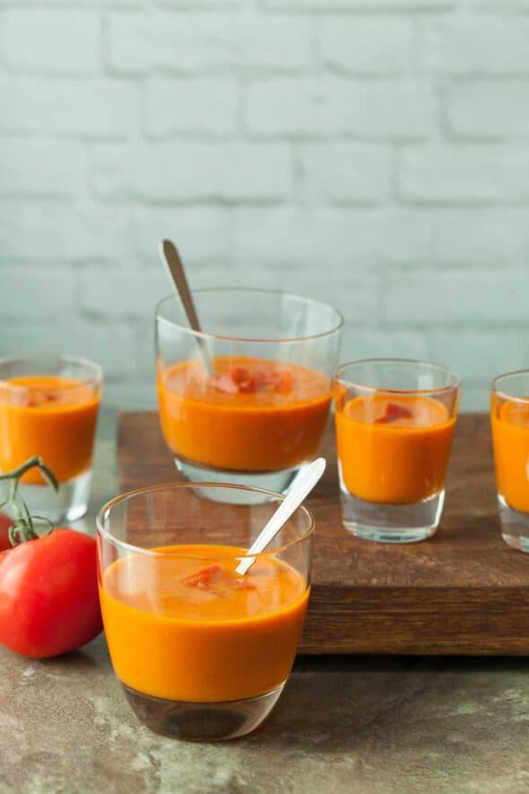 Fire Roasted Tomato and Red Pepper Soup Recipe - Fire roasted tomatoes and red peppers make a bright, spicy and slightly smokey soup that's equally delicious hot or chilled.
