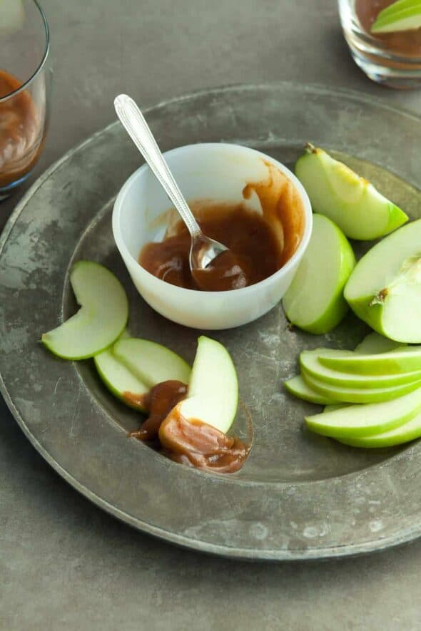 Caramel Apple Cider Dip (Paleo, Vegan) - This caramel apple dip made with fresh apple cider and Medjool dates pairs perfectly with crisp, freshly sliced apples for a seasonal fall treat. #apple #caramel #fall #snack #treat #healthy #afterschool #recipe #paleo #vegan