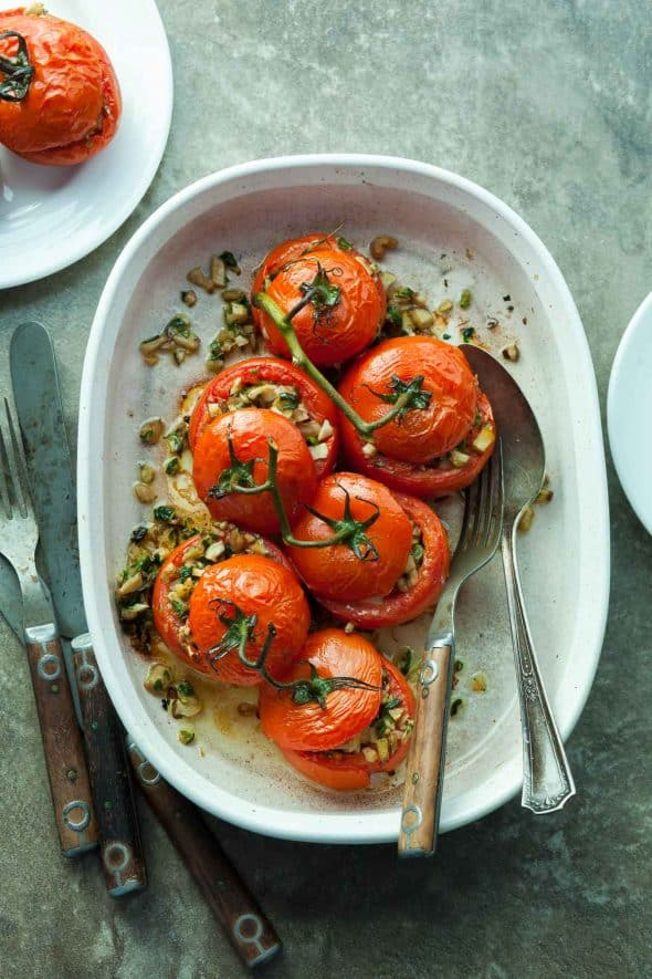Zucchini and Mushroom Stuffed Tomatoes in Baking Dish with Spoon