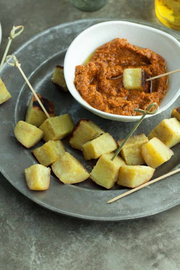 Roasted Japanese Sweet Potatoes with Sun-Dried Tomato Romesco - Roasted Japanese sweet potatoes served with sun-dried tomato Romesco, makes for a deliciously quick and easy appetizer. #potatoes #romesco #bigday #appetizer