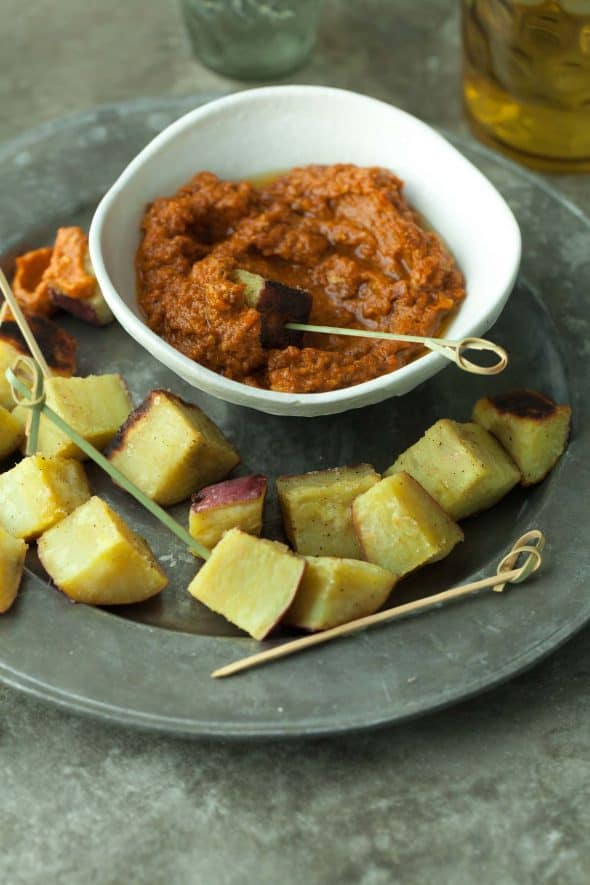 Roasted Japanese Sweet Potatoes on Toothpicks with Sun-Dried Tomato Romesco in Bowl