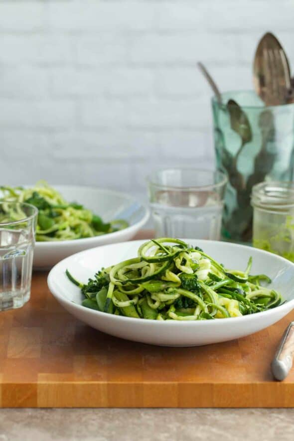 Zucchini Noodles Pistachio Pesto Primavera (Paleo) - Pasta primavera gets a makeover featuring fresh zucchini noodles a bright herby sauce and loads of fresh spring vegetables. #zucchini #asparagus #snappeas #pesto #primavera #springrecipes