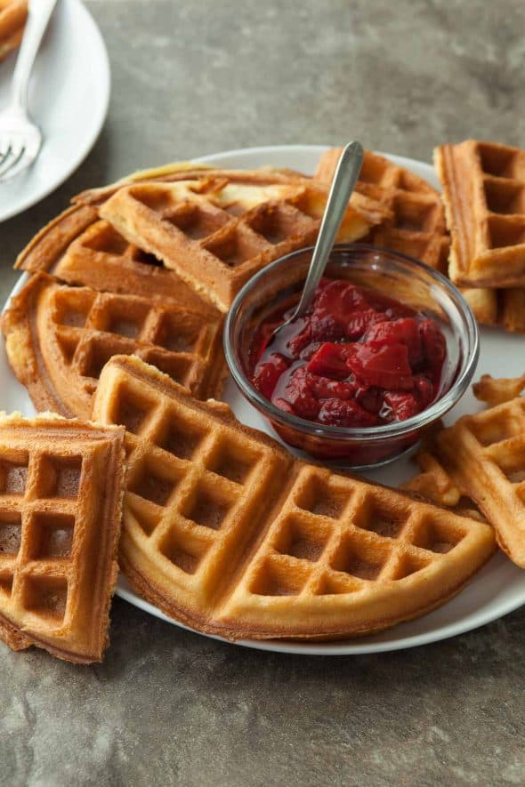 Gluten-Free Blender Waffles with Roasted Strawberry Sauce on Serving Plate