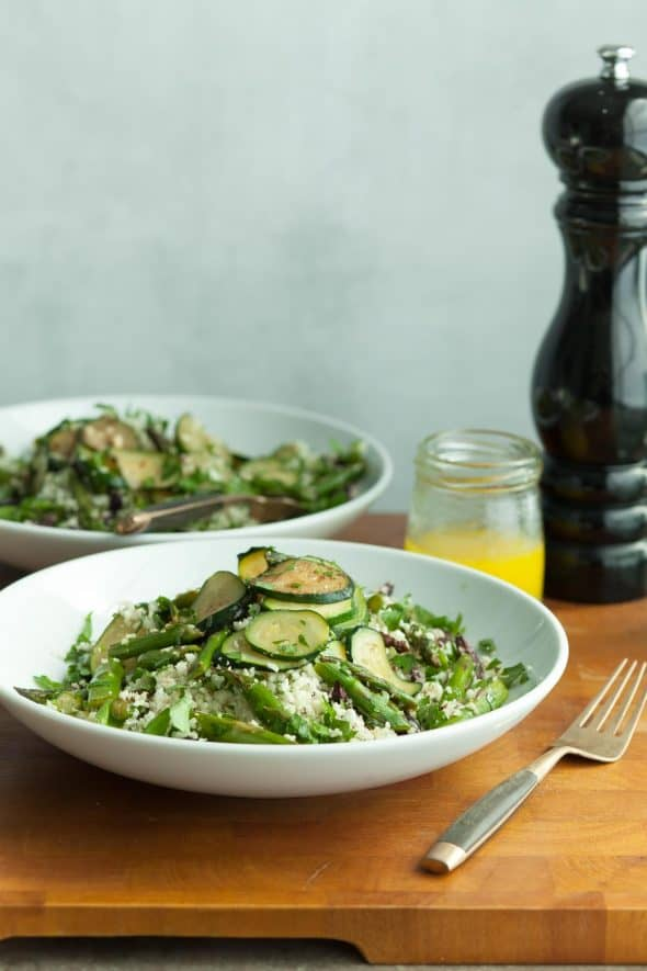 Mediterranean Cauliflower Couscous Salad with Zucchini and Asparagus on Plate with Fork