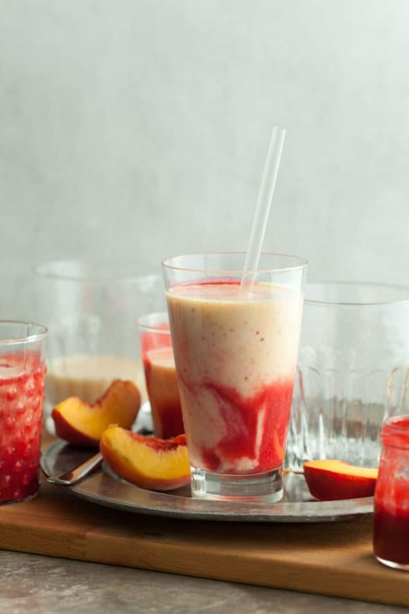 Peach Melba Lassi Recipe - This cooling and fruity peach and raspberry lassi is inspired by a classic dessert. #peach #raspberry #lassi #yogurt #drink #dessert