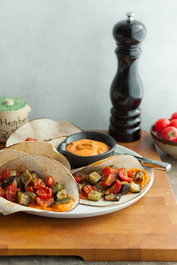Ratatouille Wraps (Paleo) - These ratatouille wraps are layered with a bright red pepper spread and a medley of roasted summer vegetables like eggplant, zucchini and tomatoes. #ratatouille #wraps #eggplant #zucchini #tomatoes #redpepper #paleo