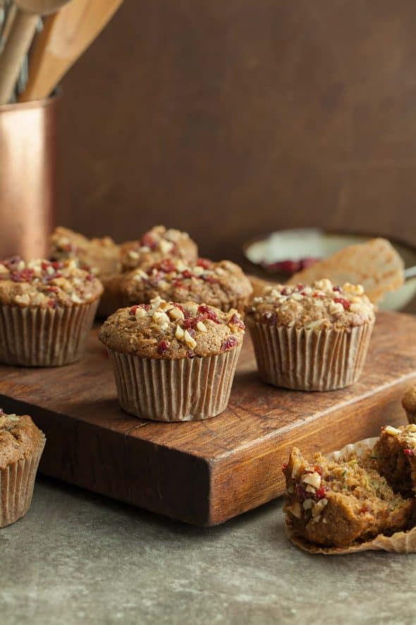 Zucchini Harvest Muffin Recipe - These hearty gluten-free muffins are packed with zucchini, dried fruit, nuts and a hint of warming fall spices. #breakfast #paleo #gluten-free #zucchini
