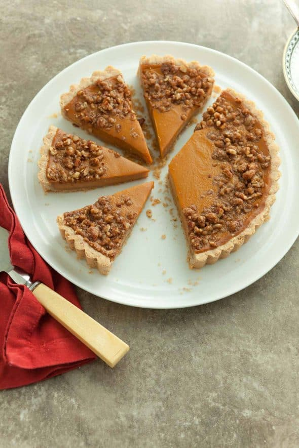 Sweet Potato Tart with Pecan Praline Topping Sliced into Wedges