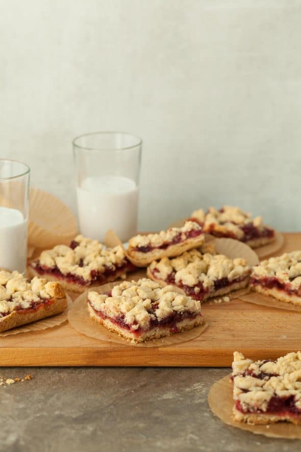 Cranberry Crumb Bars on Wood Board