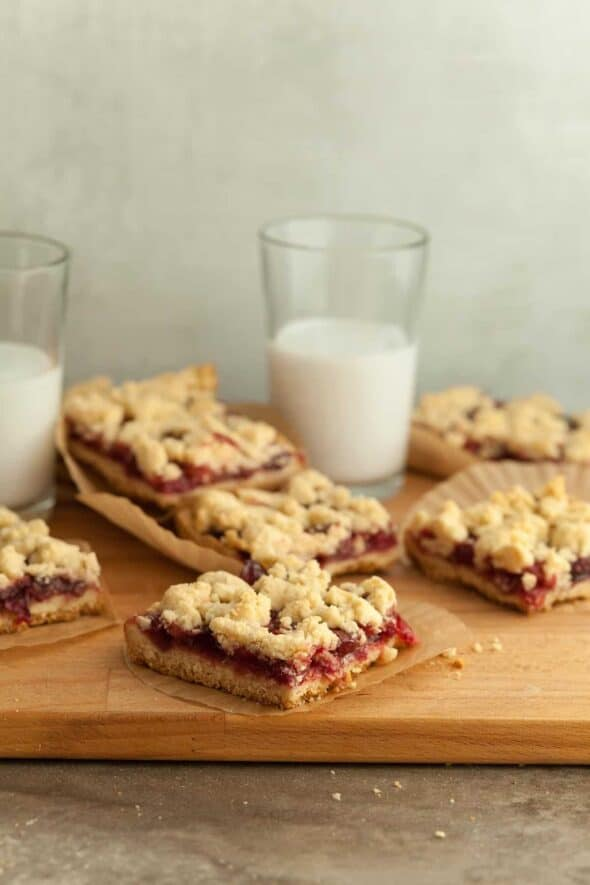 Cranberry Crumb Bars with Glasses of Milk