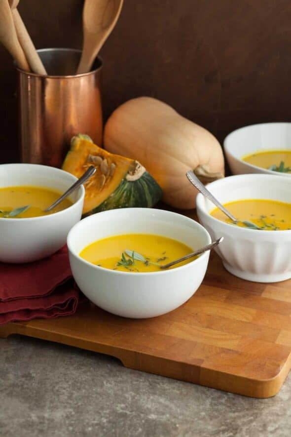 Winter Squash Soup in Bowls on Wood Board