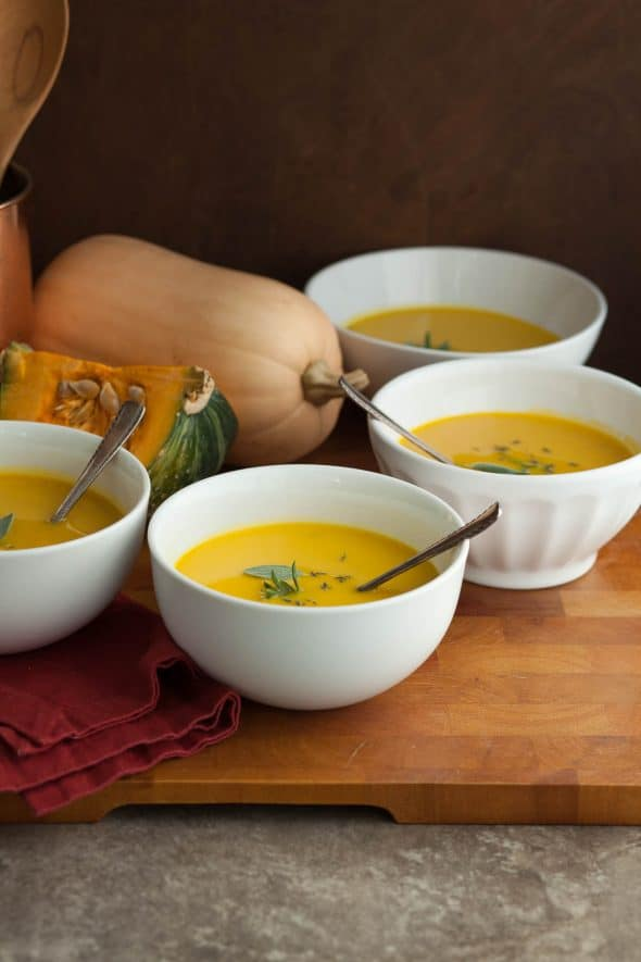 Winter Squash Soup with Red Napkin and Spoons on Board