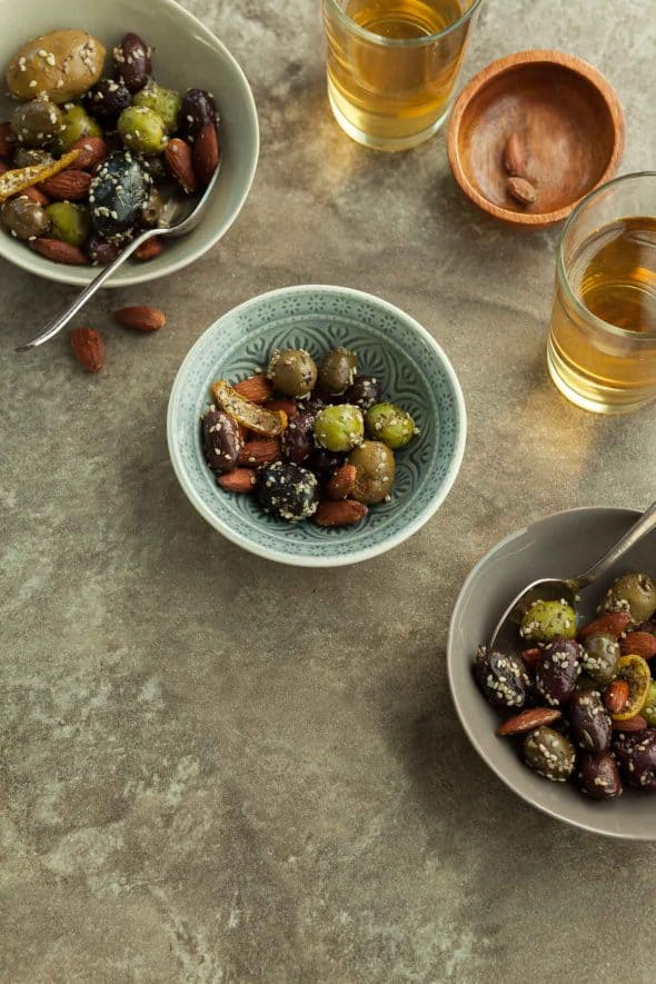 Zaatar Roasted Olives and Almonds in Bowls with Spoon