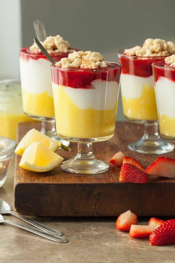 Lemon Berry Yogurt Parfaits with Shortbread Crumble in Glasses with Spoon