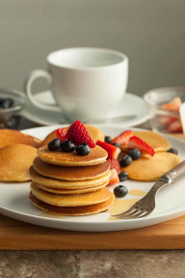 Gluten-Free Silver Dollar Cashew Butter Pancakes Stack with Berries on Top