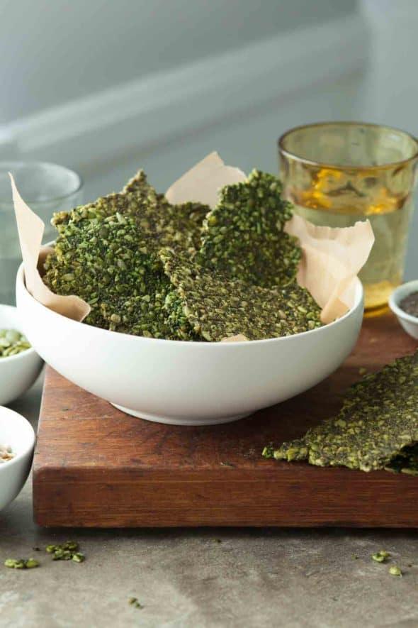 Gluten-Free Pesto Kale Seed Crackers in Bowl