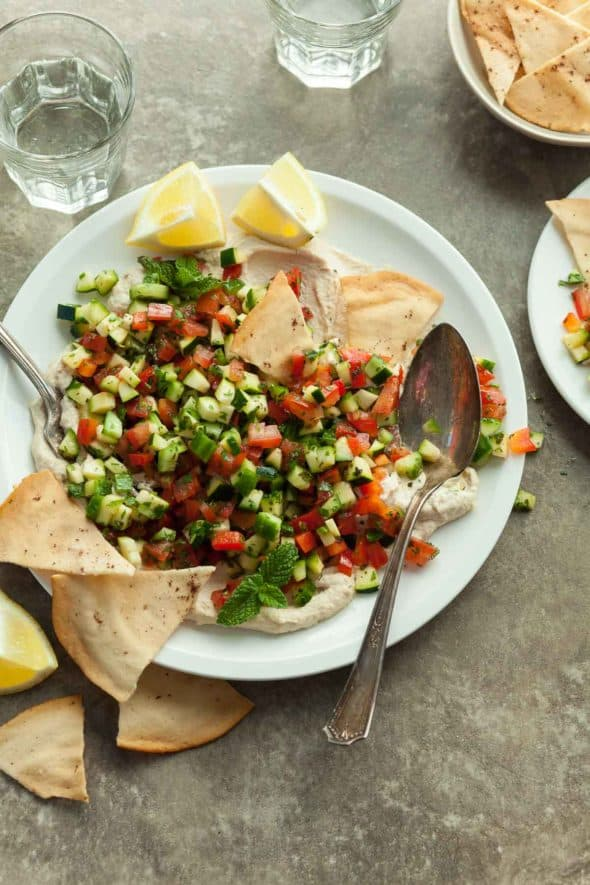Middle Eastern Chopped Tomato Cucumber Salad Served with Pita Chips