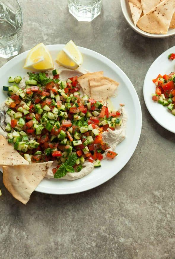 Middle Eastern Chopped Tomato Cucumber Salad on Serving Plate